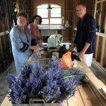 Aunt Donna and Uncle Paul helping Tara in putting together lavender bouquets.
